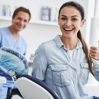 Dental patient giving thumbs up after ozone therapy in Marlton