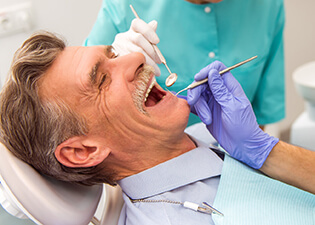 Older male patient in dental chair