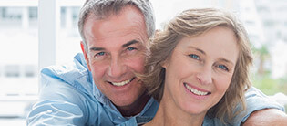 Older couple with perfect healthy smile