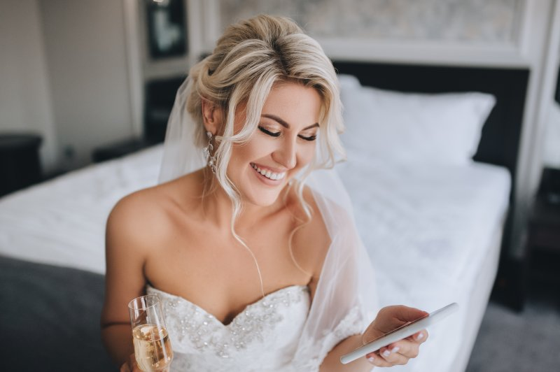 Bride with white teeth smiling on the morning of her wedding